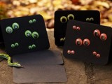 black invites with colorful googly eyes are bold, fun and easy to DIY, you can make as many as you want