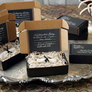 a refined black box with hay and an invite is a chic and cool idea for a modern Halloween party