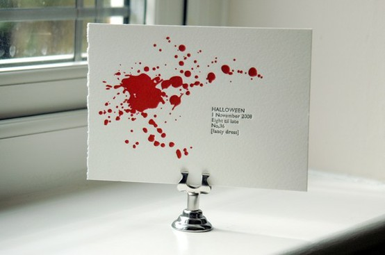 a white blood splattered Halloween party invitation is a cool idea with much style