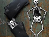black and white skeletons in black envelopes are creative and cool party invitations that look super bold