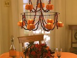a super elegant red rose centerpiece is a stylish decoration for Halloween that will bring color