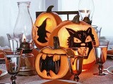 carved witch, cat and bat pumpkins will make up a cool Halloween centerpiece that you can DIY