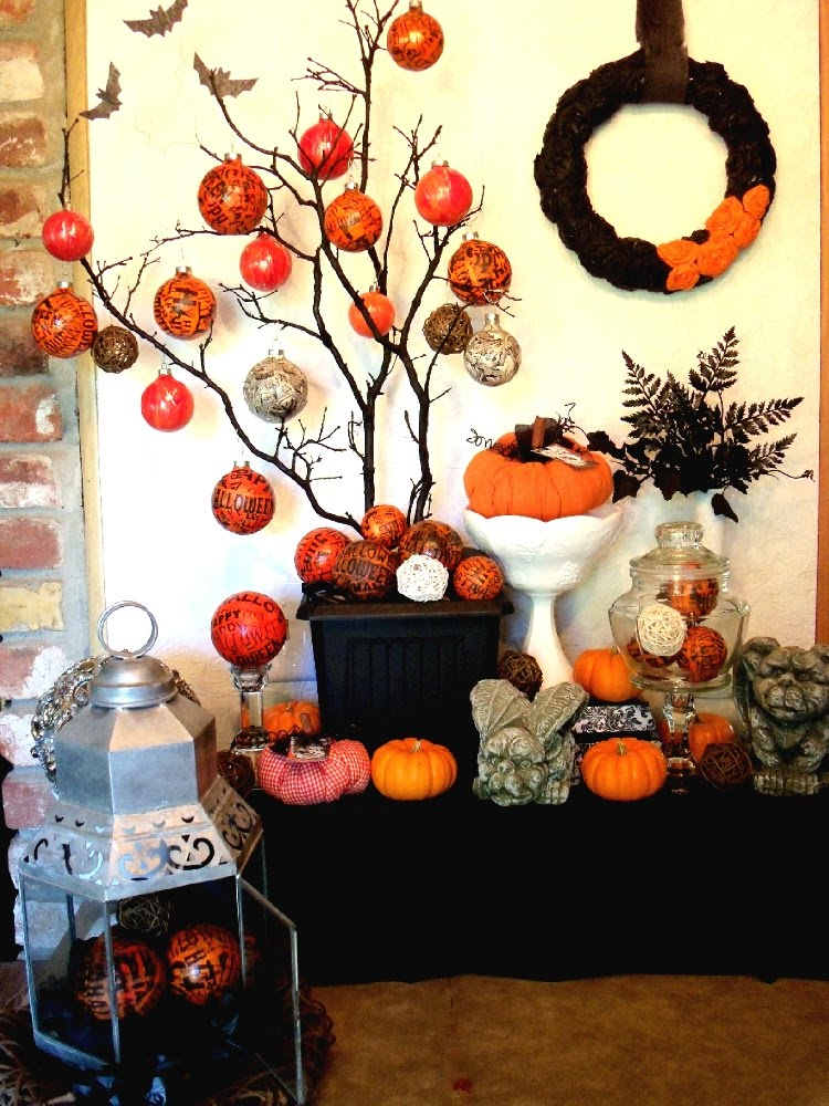 black branches in a black planter with orange and grey wrapped ornaments is a quirky and fun idea