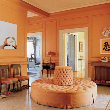 Bright orange is a happy color choice for a hallway.