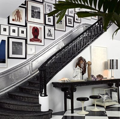Staircase gallery walls always make this dull space more interesting