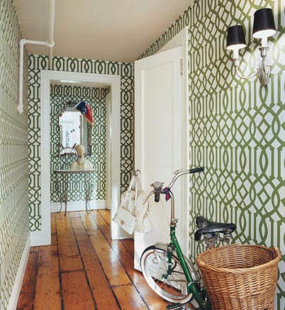 Hallway design shouldn't be boring so it's a great idea to use a dramatic wallpaper.