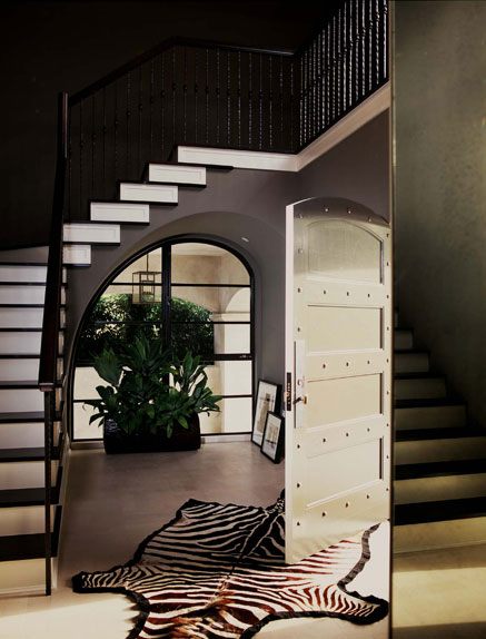 Even if your entryway is small it shouldn't look dull. Add a rug!