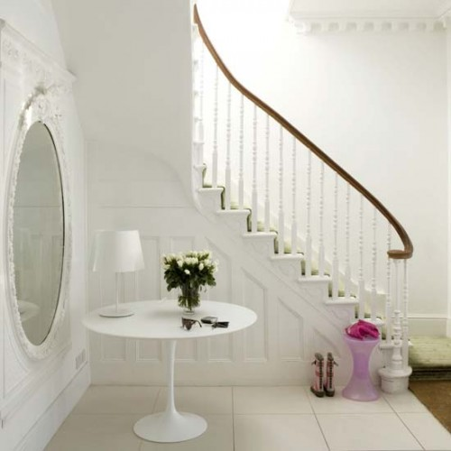 All white is an interesting color choice for a hallway decor.