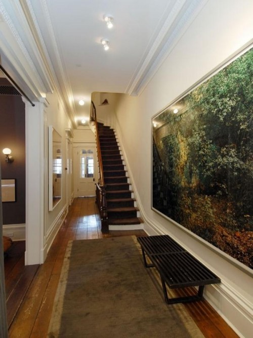 Oversized  art canvases are more than welcome for hallway decor
