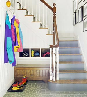 really smart hallway organization with stairs and built-in storage
