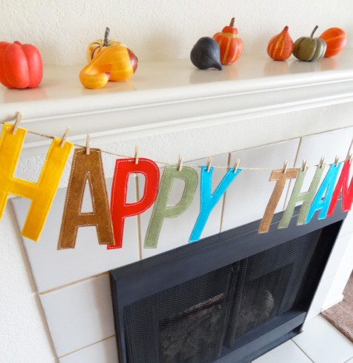 a Happy Thanksgiving garland made of bold letters is a nice solution with a modern feel and it looks bold