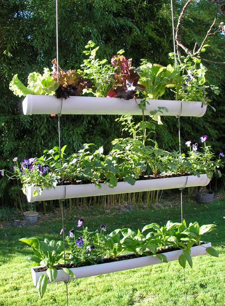 DIY Hanging Gutter Herb Garden (via shelterness)