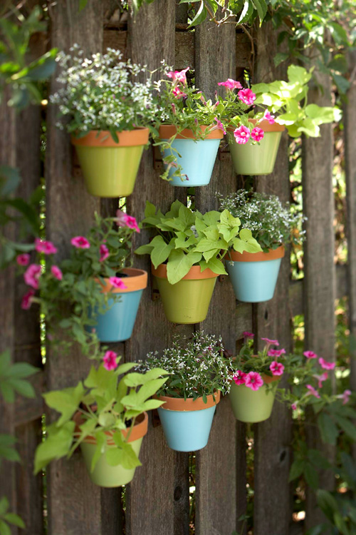 DIY Colorful Vertical Garden On A Fence (via shelterness)