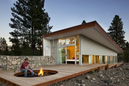 Sustainable Hill House With A Cool Fireplace On A Deck Shelterness