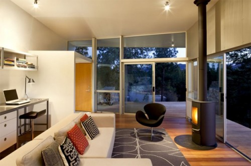 Hill House With Cool Fireplace On A Deck
