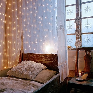 A breezy drapery combined with lights would create a whimsical effect right by your sleeping area.