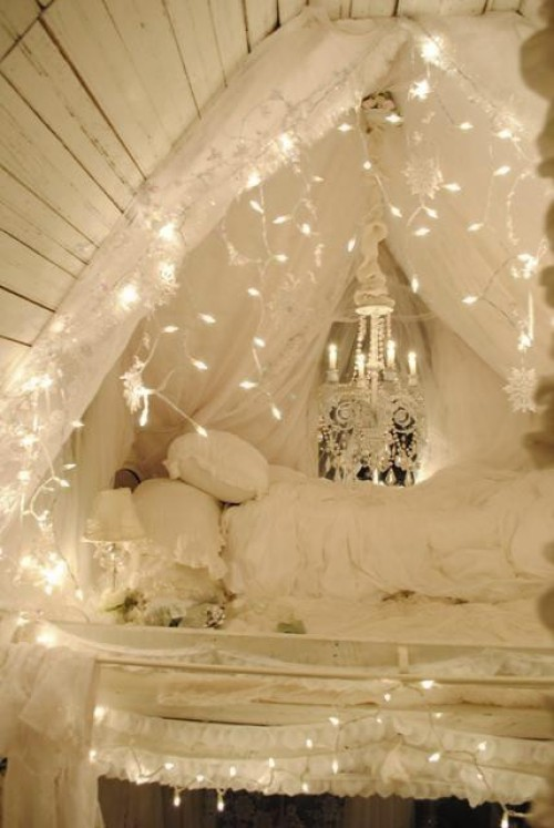 Hang string lights to make twinkling draperies and turn your bedroom into a  princess layer.
