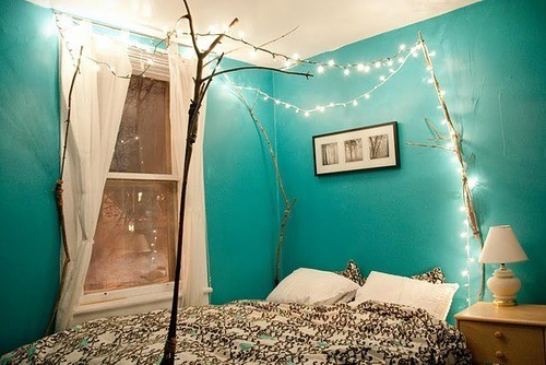 Several branches could become a great support for Christmas lights. You can mount them right to the bed.