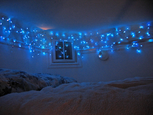 To make a wall less boring and add a Christmas sparkle to it, try adorning it with fairy lights.