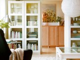 glass bookcases look lightweight and cool and hold all the necesary things you want and you need