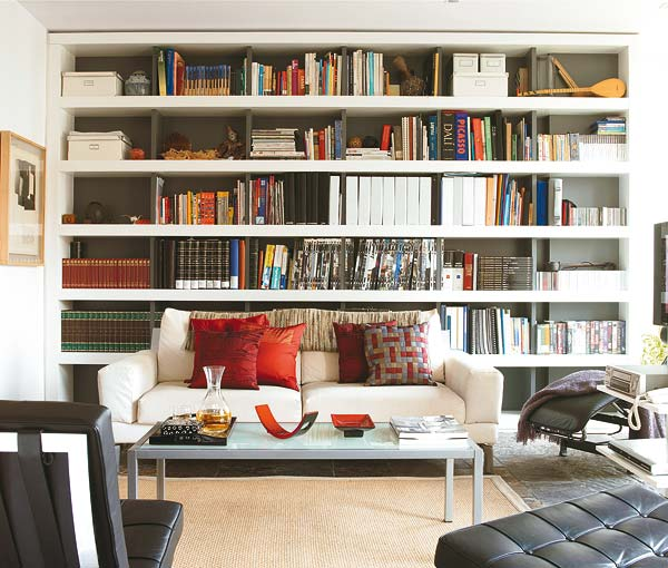long open shelves that take a whole wall is a great idea to store a lot of books and such an item doubles as a home decor piece, too