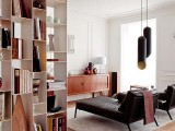 an airy white bookcase doubles as a space divider and takes no excessive space, it looks lightweight and cool