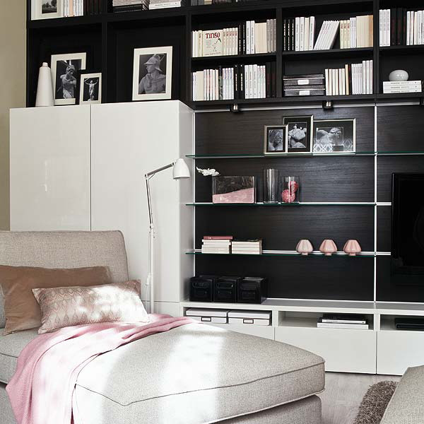 a built in bookcase and some open shelves under for storing books in the living room