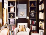 built-in bookshelves match the elegance of the room, and a white chair contrasts it and makes the space look bolder