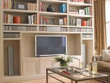 a neutral bookcase with a built-in TV unit is a good idea to rock in a modern space