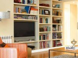 a large built-in bookcase in a light shade is a classic thing as it accommodates a lot of things and doesn't look bulky thanks to its color