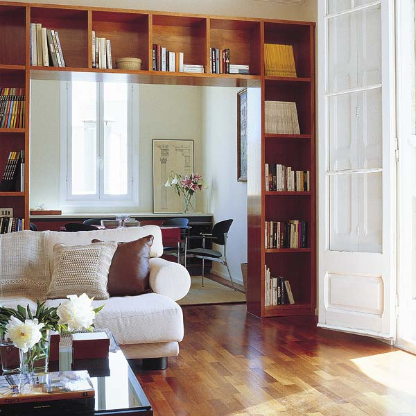 cover the doorway with a large bookcase for storing anything you want and you like