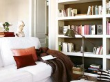 a built-in white bookcase with black inside is a cool and stylish idea for a contemporary space