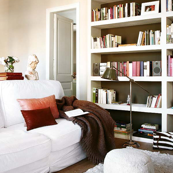 a built in white bookcase with black inside is a cool and stylish idea for a contemporary space