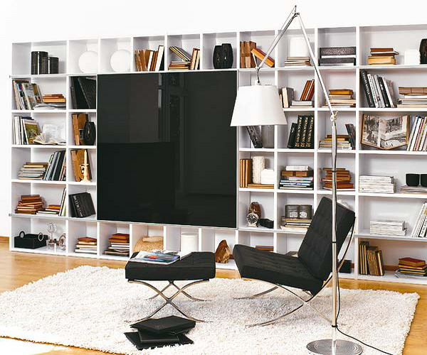 a large white bookcase that take a whole wall is a great idea to go for and it looks very modern and up to date