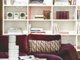 a large white bookcase won't look bulky and will accommodate a lot of stuff while being nice part of decor