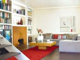 a refined living room with built-in bookshelves over the fireplace make the space very cozy and welcoming