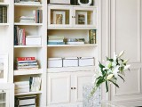 elegant white storage units with built-in bookshelves are a nice idea to go for, they will store a lot of things