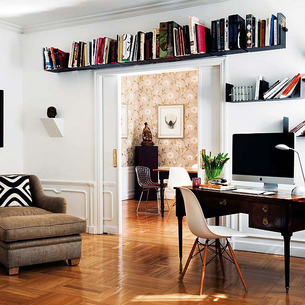 a black shelf over the door is a cool idea to store books in a fuctional way and it doesn't take any space you may need