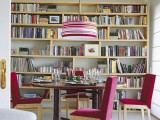 a large open bookcase covering the whole wall is a cool idea to accommodate a lot of books and turn your space into a library