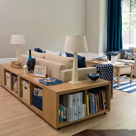 a comfortable modern storage unit for books and other stuff can be placed behind your sofa in the living room to save some space