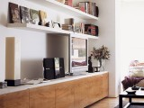 open bookshelves over the TV unit don't look bulky and are comfortable for storage, plus open shelves are very trendy now