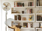 a set of creative geometric bookshelves, a wire chair and a rug are all that you need to create a comfortable and cozy reading nook