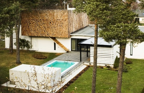 House Extension Covered With Crisscrossed Sticks