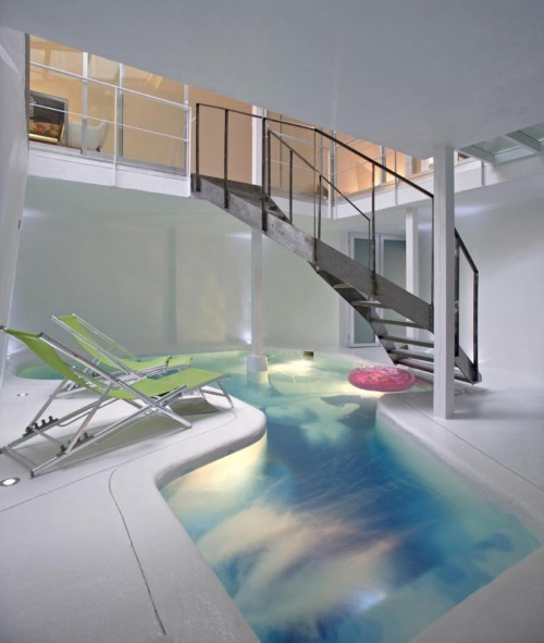 Refurbishment Of An Old House With A Pool On The First Level