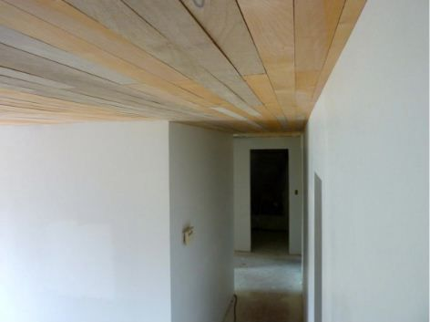 rough wood planked ceiling (via thestir)