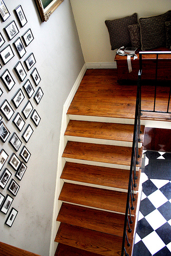 Arrange photos near the staircase to give a new meaning to a boring wall