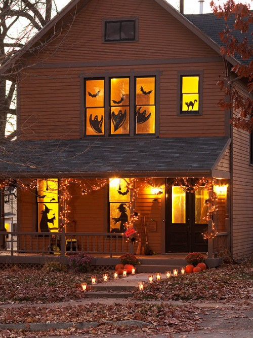 All front windows could be decorated with silhouettes. Cats, ghosts, bats and witches would work as a charm.