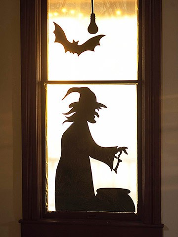 A witch making poison is always a nice window decoration idea for Halloween.