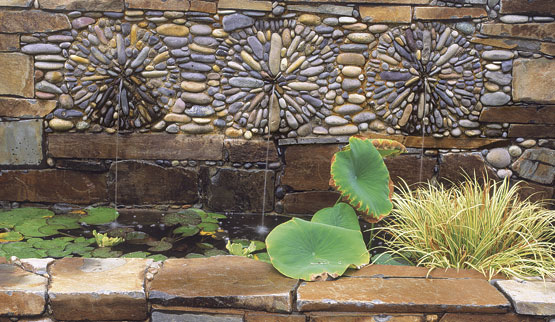 Picture of how to make pebble mosaic for your garden walkways for Garden wall mosaic designs