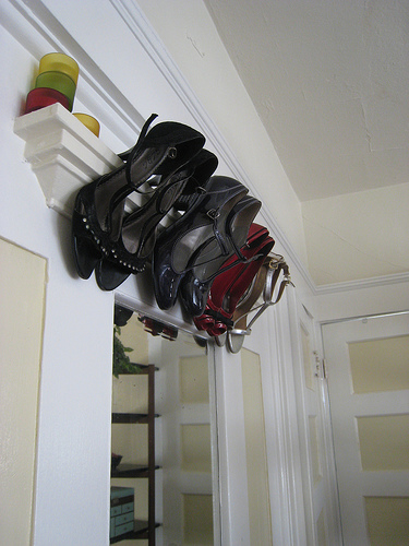 In small apartments you can even use a space above doors to store your shoes.